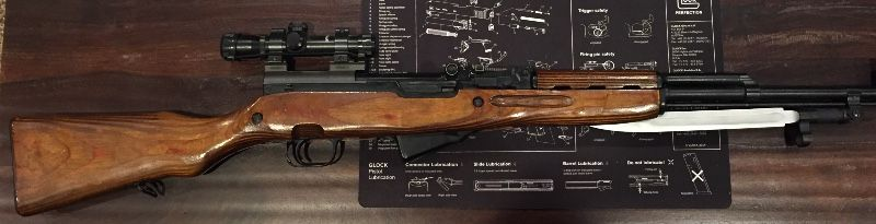 RUSSIAN SKS WITH RED STAR SCOPE.